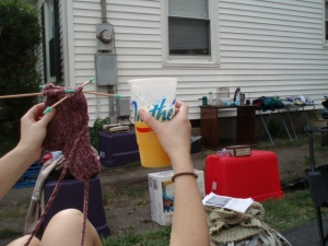 Sally sippin' with her sock at the 'sale!
